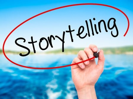 52721047 - man hand writing storytelling with black marker on visual screen. isolated on background. business, technology, internet concept. stock photo
